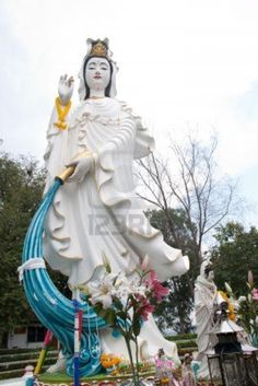KUAN YIN* Arielle Gabriel writes about miracles and travel in The Goddess of Mercy & The Dept of Miracles also free China toys and paper dolls at The China Adventures of Arielle Gabriel *