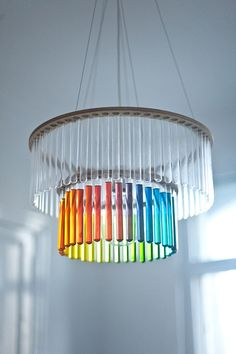 Maria S.C. chandelier is made from laboratory test tubes, set in two plywood bands. This surprising material and geometric shape makes this lamp both
