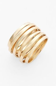 Flattened ring bands of 14-karat gold are artistically and conveniently soldered together for a modern stacked-look ring. (Size 6)