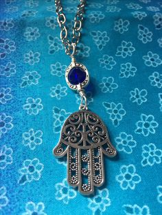 All silver with crystal bead.20 inches long.$20.00 plus $5.00 shipping