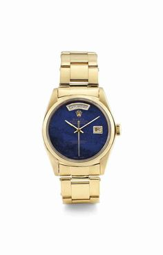 Rolex. An 18K gold automatic wristwatch with sweep centre seconds, day, date, bracelet and lapis lazuli dial. circa 1977. #watch