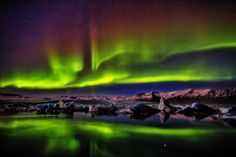 Aurora snake dances over a dying glacier, Jökulsarlon, Iceland ✯ ωнιмѕу ѕαη∂у Beautiful Sky, Beautiful World, Sky And Clouds, Aurora Borealis, Night Time, Norway, Northern Lights, Surfing, Places To Visit