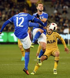 Juventus' midfielder Miralem Pjanic (C) clears the ball from the possession of Tottenham Hotspur's Christian Eriksen (R) during the International Champions Cup football match between Italy's Serie A team Juventus and Premier League team Tottenham Hotspur in Melbourne on July 26, 2016.  / AFP / SAEED KHAN / IMAGE RESTRICTED TO EDITORIAL USE - STRICTLY NO COMMERCIAL USE