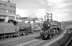 At the eastern end of Bournemouth Central N class 2-6-0 31405 waits with a local for Eastleigh, while BR Standard 2-6-0 76069 passes through on the relief road with a westbound mixed freight.   Hampshire, UK. Negative scan.