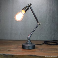 This elegant industrial lamp fits a variety of environments including any office or study . The entire fixture is adjustable using aged brass