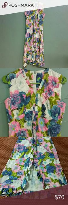 """Vintage Boutique of California dress Beautiful floral pattern with ruffles starting at the waist.  This dres stops below the knee in front but is longer in the back. Zips up the back. Lying flat: 35 1/2"""" to front hem, 50 1/2"""" to back hem, 18"""" pit to pit.  Fits me perfectly  (size 6). Vintage Dresses High Low"""