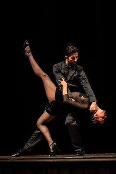 Male dancer dips female