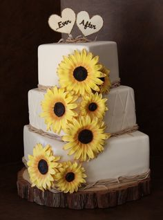 Sunflower Wedding Cake: Inspiration (love the flowers here but I would make the centers a fuller to make them look a little less daisy-like)