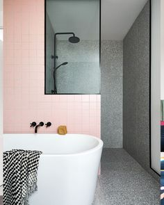 Nostalgic vibes are created by a pop of dusty pink porcelain tiles, a nod to the offset by Meir matte black tapware for a modern twist. Pink Bathroom Tiles, Pink Tiles, Quirky Bathroom, Family Bathroom, Shower Basin, Pink Showers, Black Shower, Bathroom Styling, Bathroom Renovations