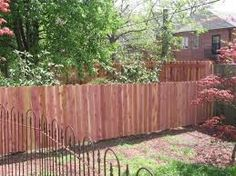 wood fence on side and back, iron fence around front - Google Search