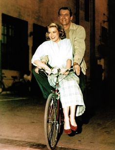 Jimmy Stewart and Grace Kelly go for a ride on the set of Hitchcock's Rear Window.