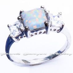 'Princess Cut Fire Opal & White Topaz Trinity Ring' is going up for auction at  3pm Fri, Mar 8 with a starting bid of $12.