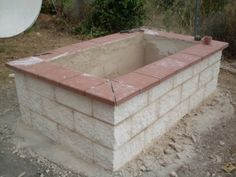Stucco is applied to the sides of the raised bed Or add glass