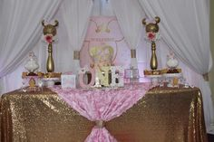 Pink and gold glam Minnie Mouse birthday party dessert table! See more party ideas at CatchMyParty.com!