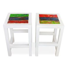 Clean white frame anchors colorful planks and provides a great focal point for any counter or bar. Made of reclaimed and renewable boat wood, this environmentally conscious stool is the perfect addition to your space.