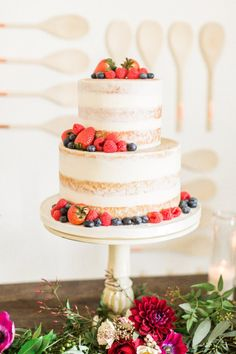 Two tier strawberry and blueberry topped cake: http://www.stylemepretty.com/living/2017/03/17/a-modern-meets-rustic-shower-to-celebrate-baby/ Photography: Katie Jackson - http://www.katiejacksonphotography.com/