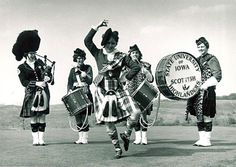 Women only - Lynn Whenshell with Scottish Highlanders performing drum dance, The University of Iowa, 1963.