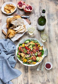 A delicious Middle Eastern Fattoush salad recipe of chopped vegetables and toasted pita bread that is versatile and pairs really well with roast chicken.