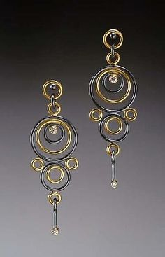 Earrings | Ben Neubauer.  Oxidized sterling silver and 18-karat gold with 2mm and 1.8mm diamonds.