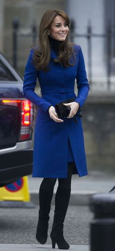 It's been a busy week for Kate Middleton, buzzing from her first-ever State Banquet and a secondary outing with the Chinese president to Scotland, where she and Prince William are supporting the Scottish Mental Health Arts and Film Festival. For her third stylish outing this week, the Duchess went local, wearing a blue wool coat from Scottish designer Christopher Kane and a matching Kane-designed kilt underneath. Her clutch is by Stuart Weitzman and her boots are Aquatalia (they look like th