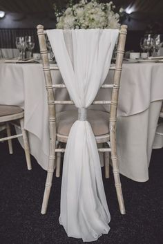 White Chiffon Chair Decor & Silver Tie | Cherish by Suzanne Neville | Luxury Coastal Wedding At Oldwalls | White on White Colour Scheme Images by Marc Smith Photography | http://www.rockmywedding.co.uk/tassy-chris/ #ChairDecorations
