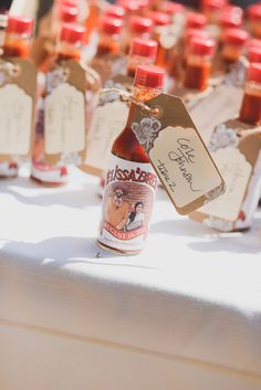 personalized Cholula hot sauce escort cards and wedding favors all in one! #favors #escortcard #hotsauce #spicy http://www.weddingchicks.com/2013/11/12/sonoma-backyard-wedding/