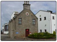 A photo of the Royal Brackla Distillery in Nairn within the Highlands of Scotland.