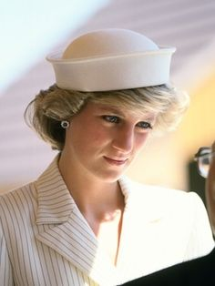 Diana 1985 in Italy wearing a coat dress designed by Catherine Walker and hat by Kangol.
