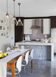 An outdated and dusty kitchen is opened up and simplified making for the perfect kitchen makeover. A hub to socialise as well as cook in!