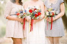 mostly light colored bouquets with red and blue touches - maybe powder blue maid of honor dress?