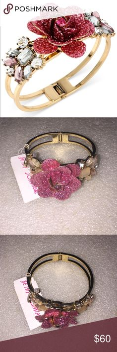 Betsey Johnson bangle Selling to buy betsey pieces I need. This is from the rose collection. The bangle is gold tone. The gorgeous charm is of a fuchsia glitter rose with rhinestones at the edge. NWT Betsey Johnson Jewelry Bracelets