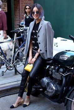 Model Irene Kim at New York Fashion Week in a Thom Browne jacket, Adam Selman top, Polo Ralph Lauren pants, Chanel slingbacks and Fendi bag. Photo: Angela Datre/Fashionista