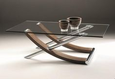 Tusk Coffee Table - the gently curved legs, in matt walnut veneer, are cleverly bisected by chrome tubing to provide a strikingly elegant design with clear tempered glass tops