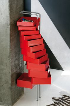 In injection-moulded ABS plastic with a structure in painted steel. The drawers can rotate up to 180°. Available also a fixed version for wall mounting. A design of Studio Joe Colombo, 2004. @b-LINE
