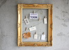 #Upcycle an old picture frame! Spray paint gold, nail twine into place and hang art with clothespins!