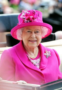 Queen Elizabeth II in a hot pink ensemble, beamed as she was driven up the course in a landau during Day 4 of Royal Ascot 2014