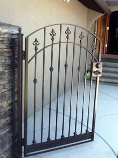 If you are looking to add detail to your yard a walkway gate is a great option. With arched, flat or reverse-curved tops, walkway gates are the perfect added touch. Wooden Gate Designs, Wrought Iron Gate Designs, Wrought Iron Garden Gates, Metal Gate Door, Metal Gates, Rod Iron Fences, Iron Staircase Railing, Balcony Grill Design, Fence Gate Design