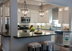 kitchen with painted white cabinets, stainless steel appliances and dark countertops. How to update oak cabinets ideas Marble Floor Kitchen, Wood Kitchen Cabinets, Oak Cabinets, White Cabinets, Butcher Block Kitchen, Dark Countertops, New Kitchen, Kitchen Ideas, Kitchen White