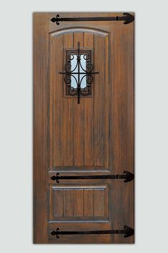 Spanish Mission style front entry door -- A dark stain, optional iron strap hinges, and a speakeasy-style window grille give this V-grooved slab its rustic appearance.