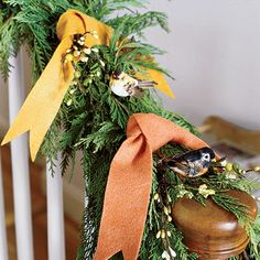 garland with greenery, birds and ribbon