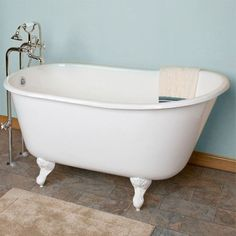 """Learn More Cambridge's most fashionable cast iron slipper tub, this elegant Swedish-inspired soaking tub is designed for those who love to venture out into deeper waters. The porcelain coated clawfoot tub sits atop brushed nickel legs and boasts an amazing 18"""" of water depth. The perfect blend of modern and vintage styles. Dimensions Size: Standard - the perfect upgrade across the widest range of bathroom renovations! External Dimensions: 58.50""""L x 29.50""""W x 29.50""""H Reviews Product Info…"""