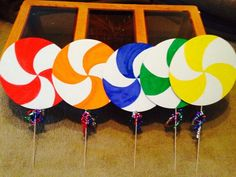 Lollipops guild. Pizza cardboard rounds watercolor curling ribbon wooden sticks.