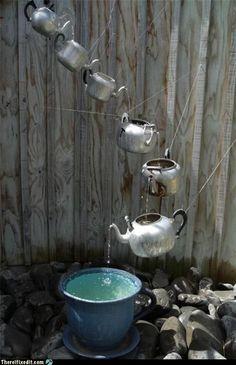 teapot waterfall for garden.. FUN Thrift store project!