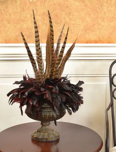 Bold And Exotic Pheasant Feather Floral Arrangement - Add a bold and exotic feel to your room with this striking feather design. The lovely pheasant feathers add height with shorter coque feathers around the edge of the urn. Urn is made of resin Sunflower Arrangements, Silk Floral Arrangements, Beautiful Flower Arrangements, Beautiful Flowers, Phesant Feathers, Feather Centerpieces, Silk Flowers, Colorful Flowers, White Flowers