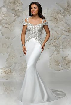 Cristiano Lucci. Glamorous and vintage inspired sheath dress with plunging neckline. Off-the-shoulder sleeves embellished with exquisite beading.