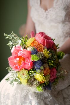Billowing pink peonies, roses, succulents and blue thistle combined to create a bridal bouquet in a spread of springtime colors.