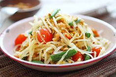 som tam #thai green papaya salad.  be gentle with the beans.  don't hurt the tomatoes, just split them.  add carrots and cilantro.  and cooked (steamed?) prawns.  #tdc