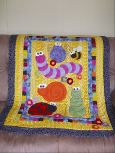 Don't Bug Me...I'm Sleeping!, This baby quilt was designed to enter in the 2007 NYS Fair...inspiration came from a brightly colored wrapping paper featuring whimsical bugs. Quilts are judged by the public then donated to a charity after the fair. This year's quilts are going to a local hospice. This is my first quilted design...I've only done two small hand-tied pieced quilts., Charity Project