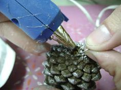 Glue rings onto cones and thread onto a hanger to make a pine cone wreath