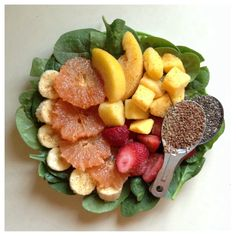Green smoothie: spinach, banana, grapefruit, frozen strawberries, pineapple, peaches, & mango, organic chia seeds, organic flax seeds, ground ginger, cayenne, and water -Drea